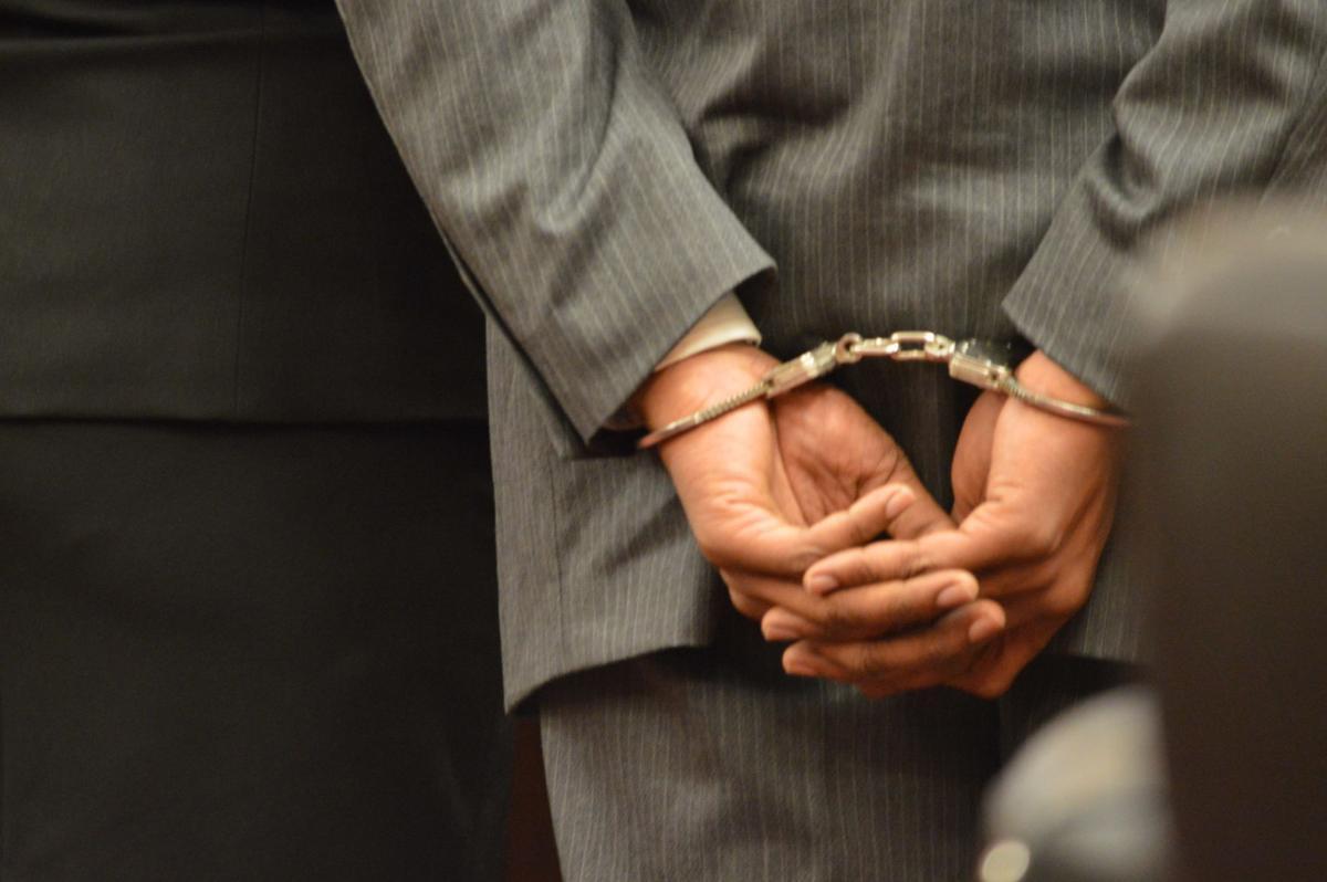 handcuffed Sanford Doss
