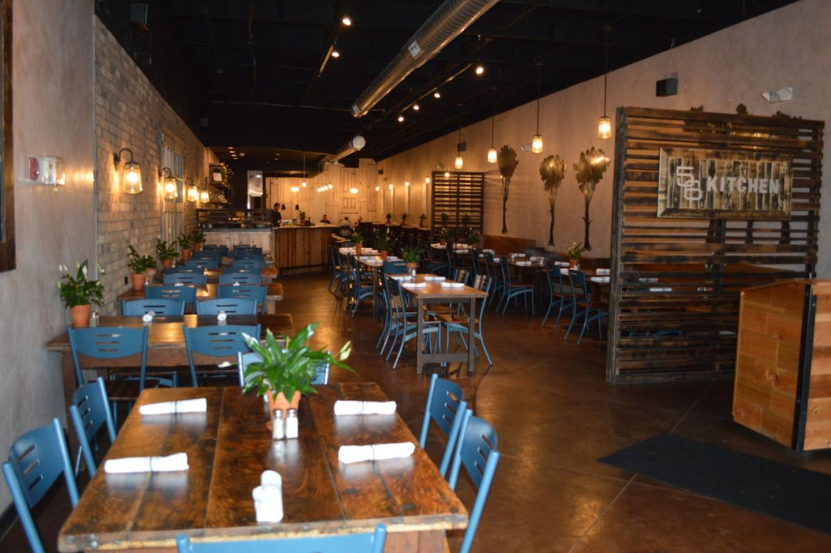 The interior of 56 kitchen features an open concept kitchen and rustic décor including 150 year old farm tables and wooden doors