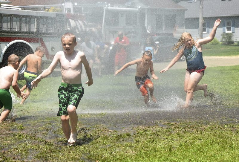Children cool off courtesy of Camanche Fire Department