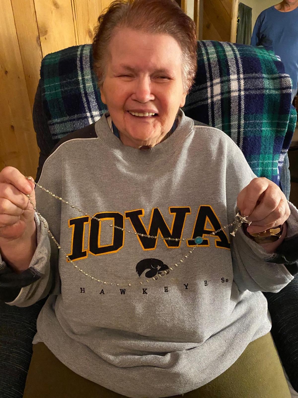 Diana Borja holding the rosary she lost 72 years ago