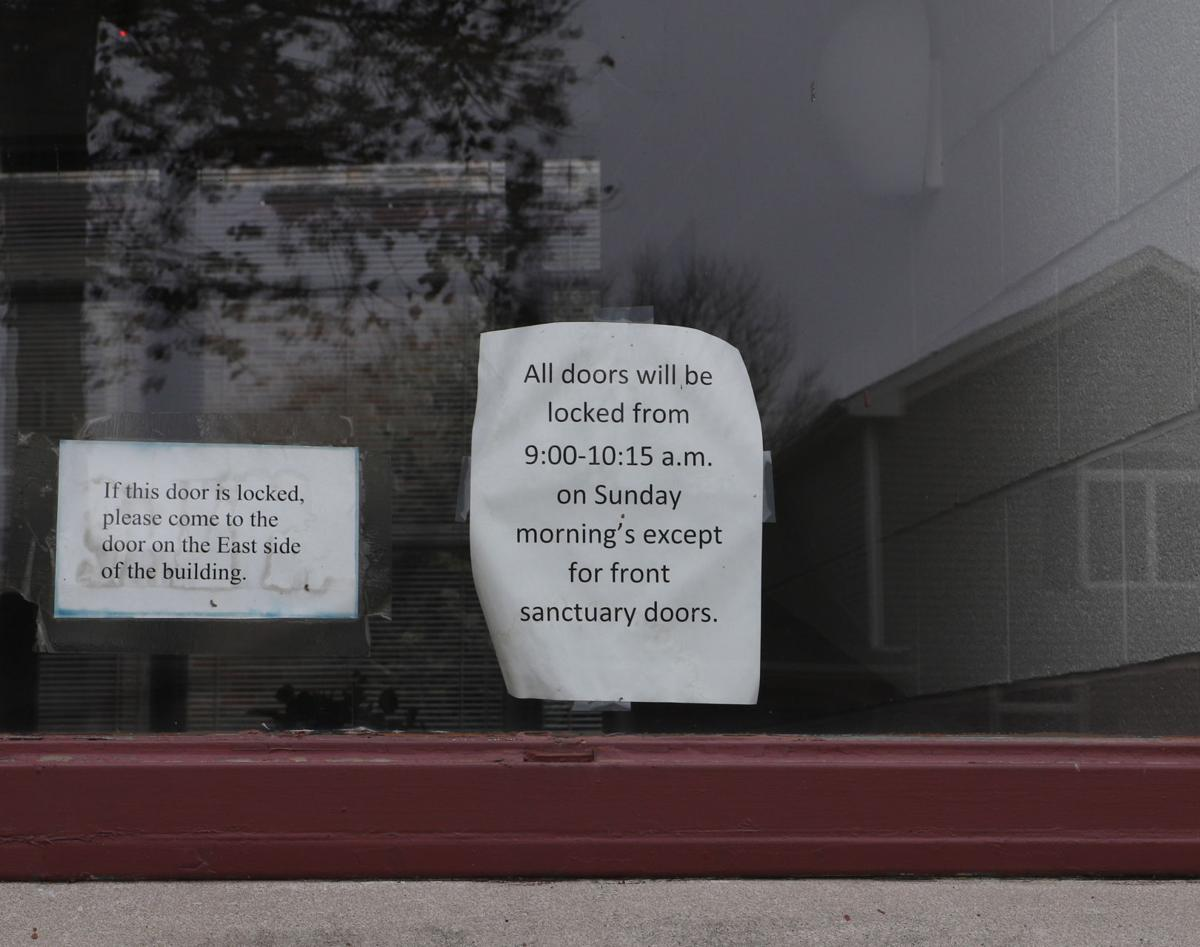 Sign about locked doors on church