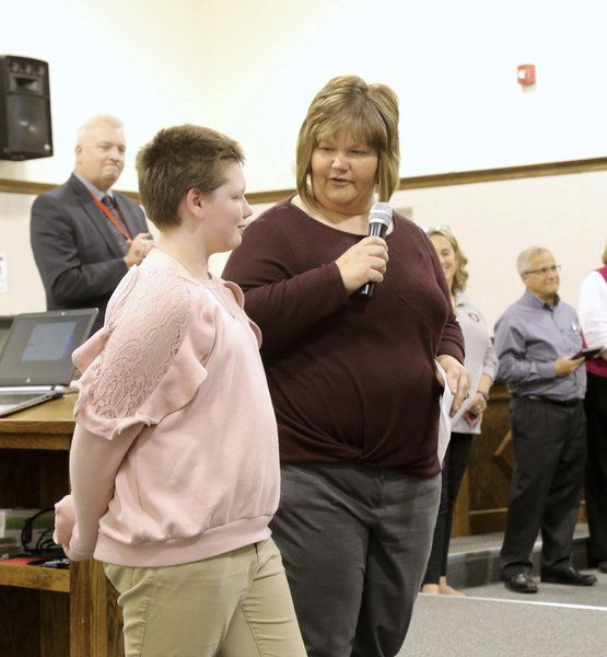 School district honors students, retirees