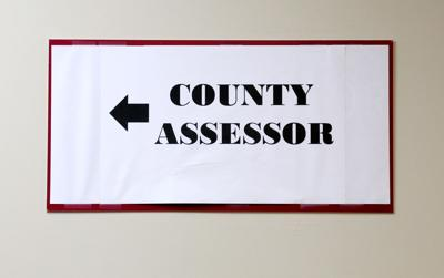 county assessor sign with arrow