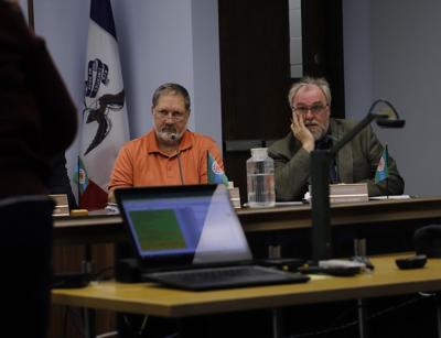 councilmen gregg obren and ron mussman listen to finance director anita dalton