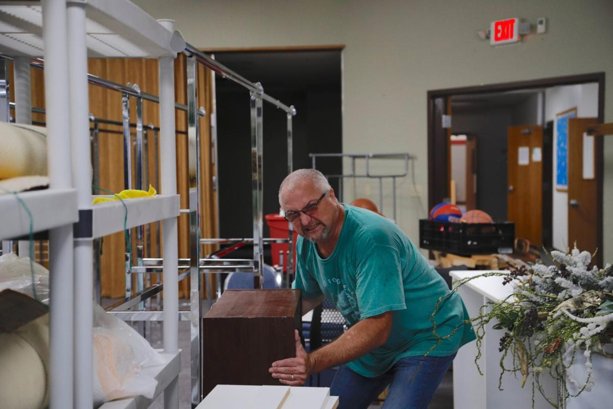 Dave Michaelsen helps move furniture to the new Information Referral building