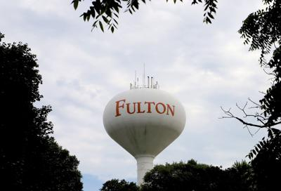 Fulton water tower framed by trees
