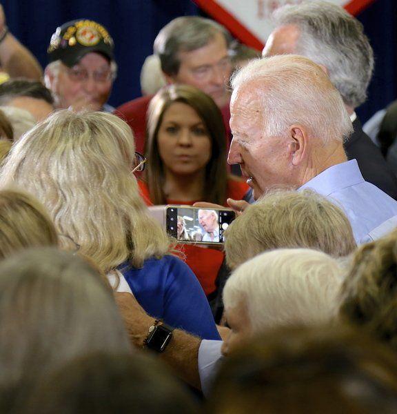 Biden revs up Clinton crowd