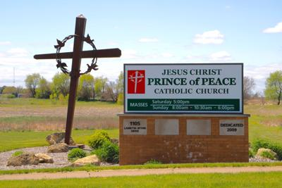 prince of peace catholic church sign and cross