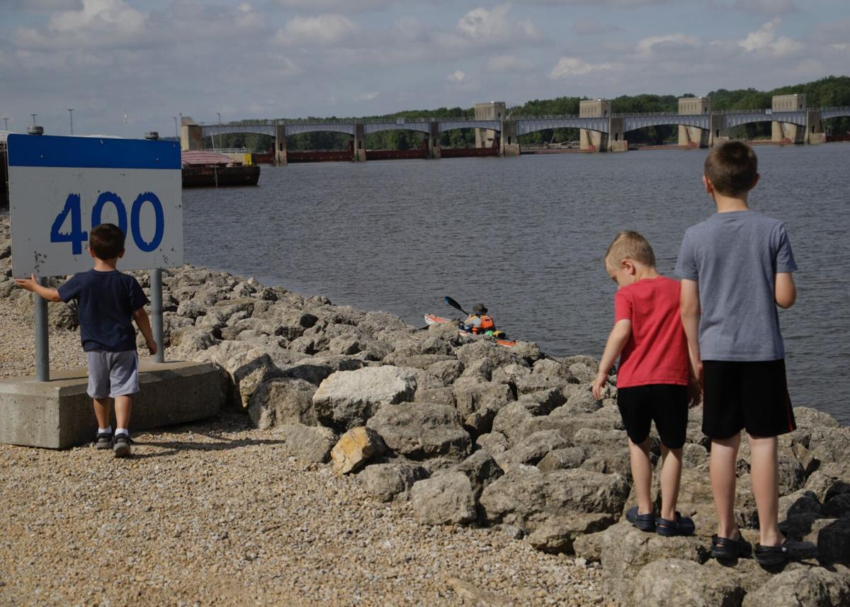 Children watch Traci Lynn Martin approach the lock
