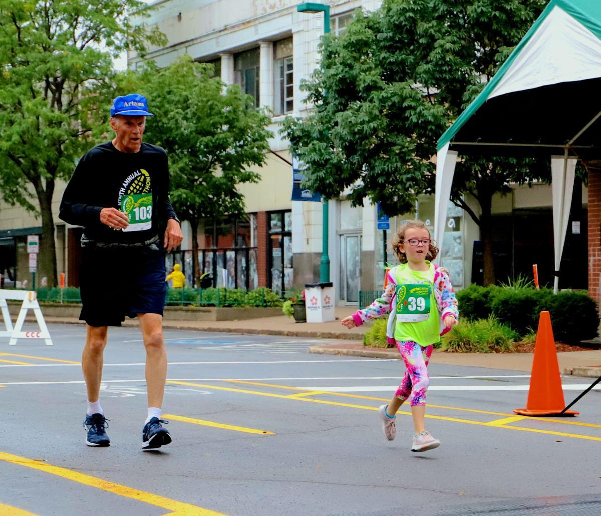 Roger Rieke, 71, and Reese Detoye, 7, finish the 5K