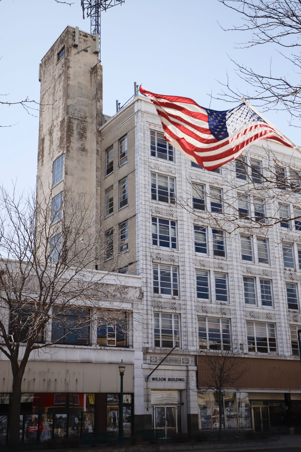 wilson building, verticle with flag