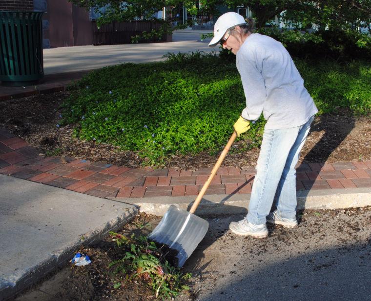 Lynn McGraw shoveling.jpg