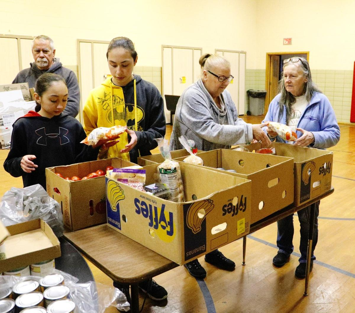 Food Pantries Move To Drive Up Delivery Service Following