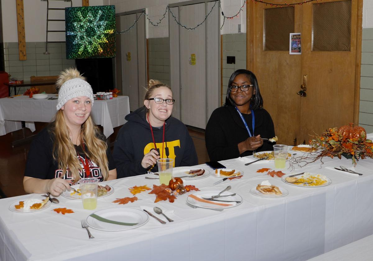 Gateway Learning Center students Ally Comstock, Breeana Doyle and substitute teacher Joma Short,Thanksgiving, Gateway Area Community Center