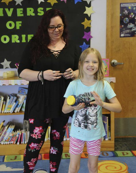 Camanche library blasts into summer
