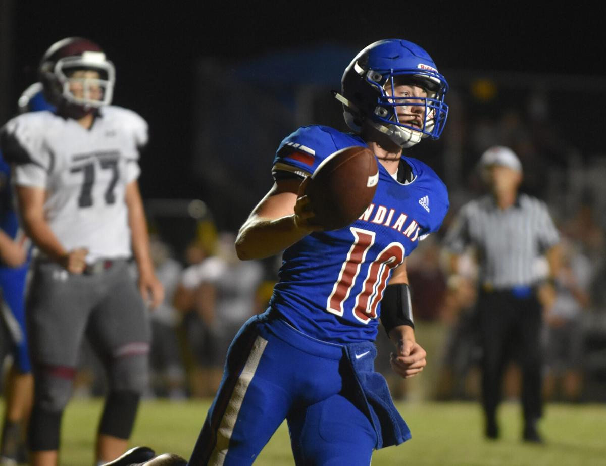 Camanche quarterback Michael Delzell against Independence