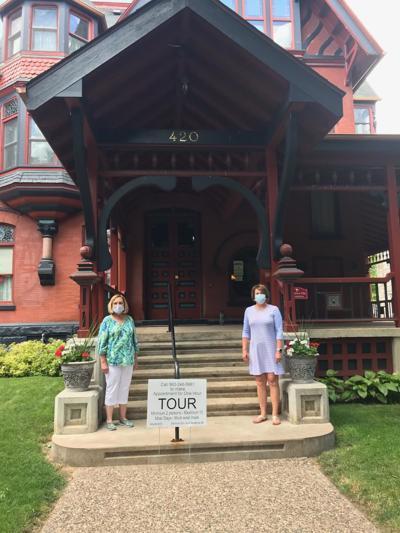 Clinton Women's Club President Karen Tate and Treasurer Teresa Yegge stand outside George Curtis Mansion