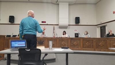 Gary DeLacy talks to school board
