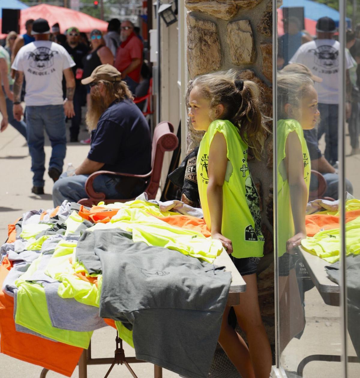 Macie Seibel sells t-shirts at Blessing of the bikes