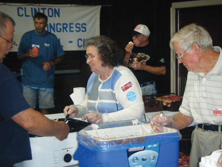 Pat and Arnie Outzen serving food 01.jpg