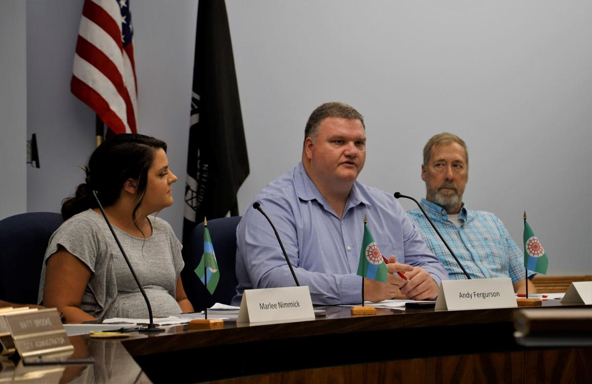 Andy Fergurson speaks, Marlee Nimmick and Ken Clarke listen