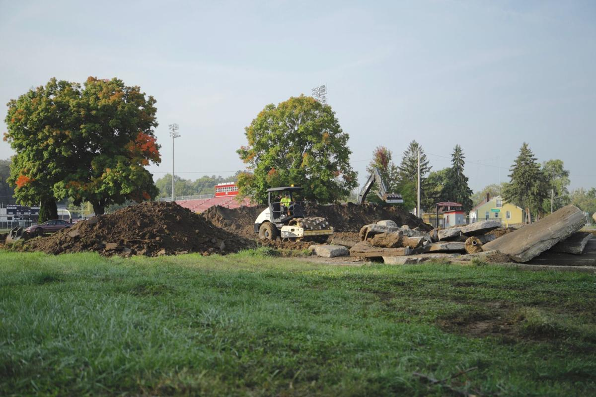 work on parking lot across from Clinton High School