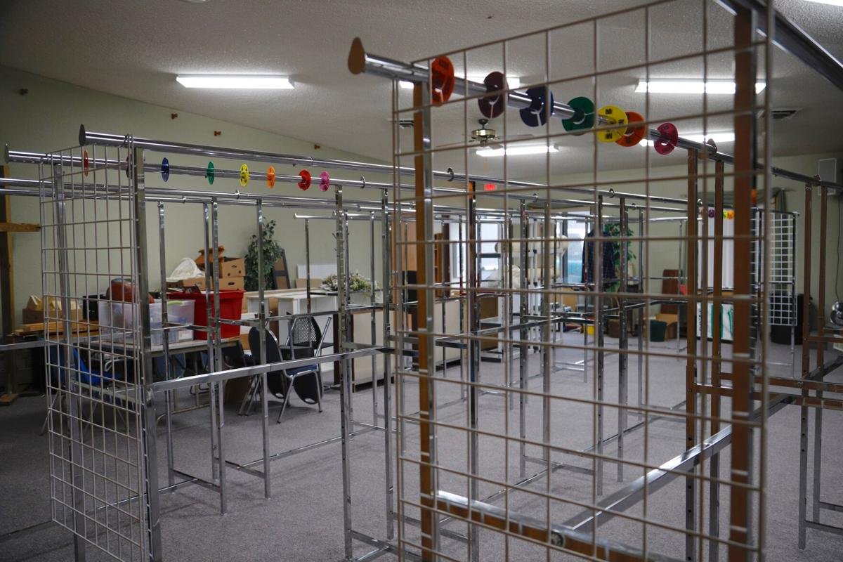 Empty clothing racks in the Information Referral, Benevolent Society building