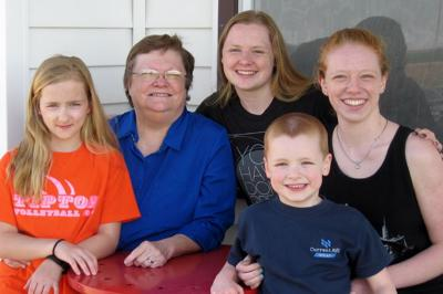 Linda Betsinger McCann with her grandkids