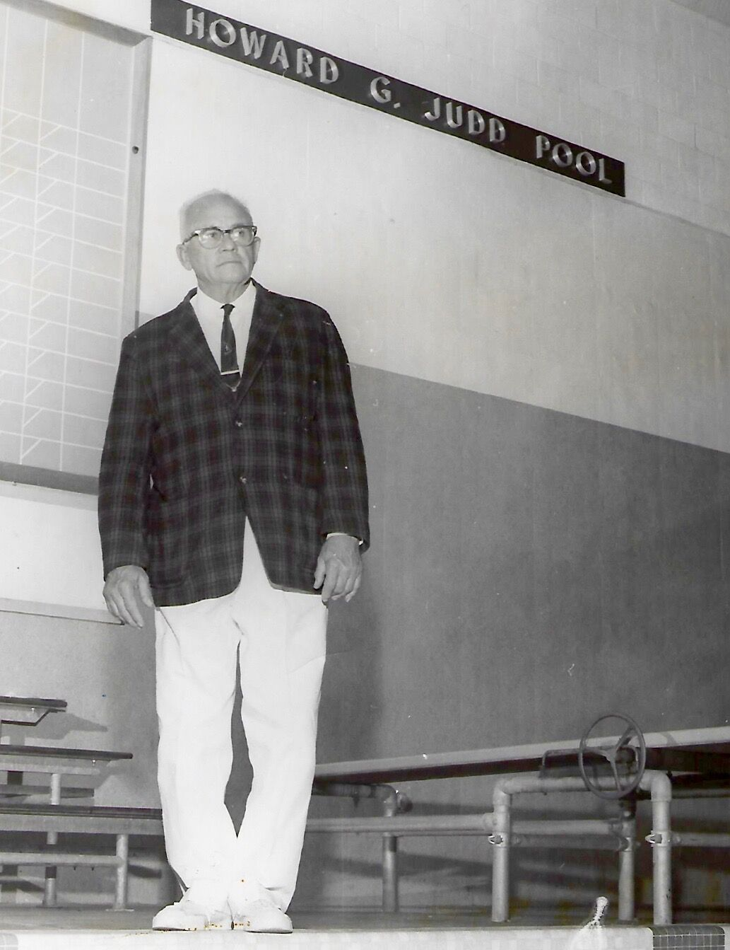 howard judd in front of pool sign