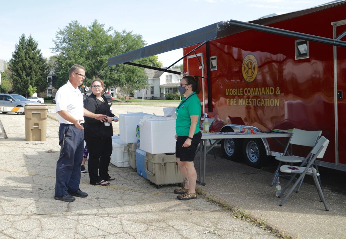 Battalion Chief Jeff Chapman, Nicole Rowan Gonner and Tanya Van Lancker man the mobile resource center in Clinton Park