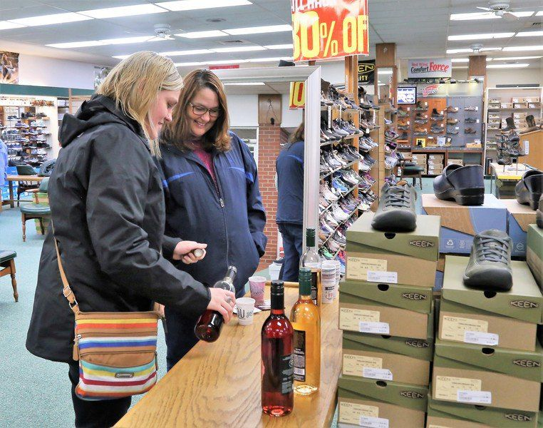 Shoppers raise their glasses in downtown Clinton