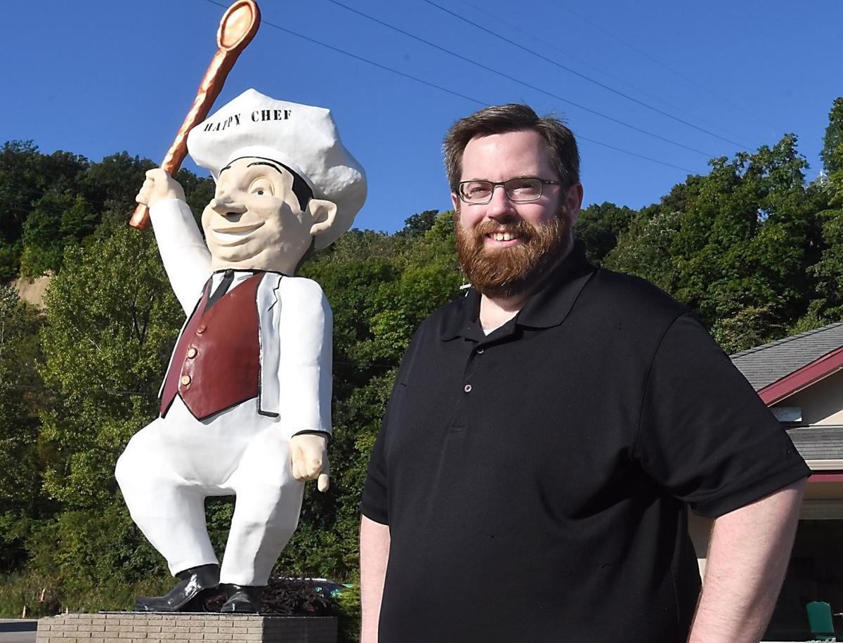 happy chef statue has his voice back