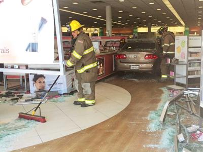 Car hits cosmetics store