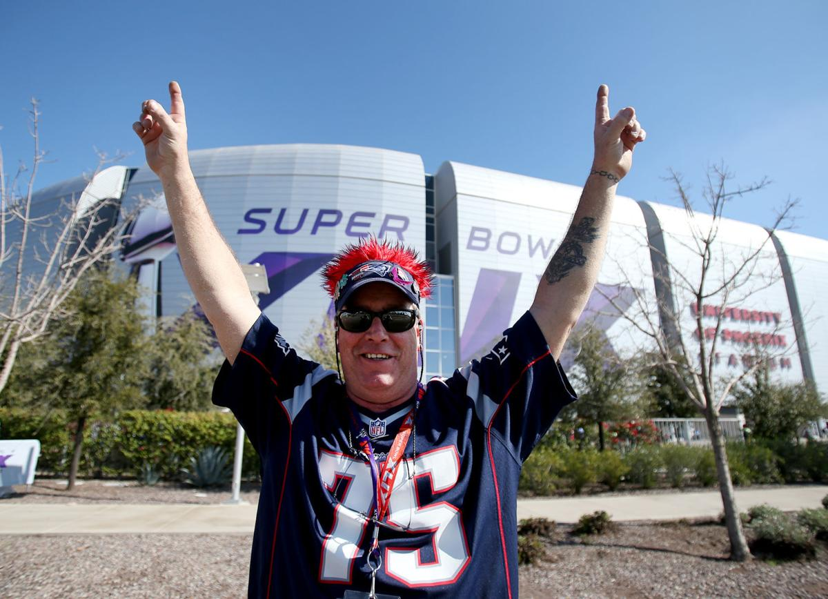 Ed Ronan, of Salem, Massachusetts, and now living in Rowley, Massachusetts, poses for a photo outside the stadium before the start of Super Bowl XLIX in Glendale, Ariz.