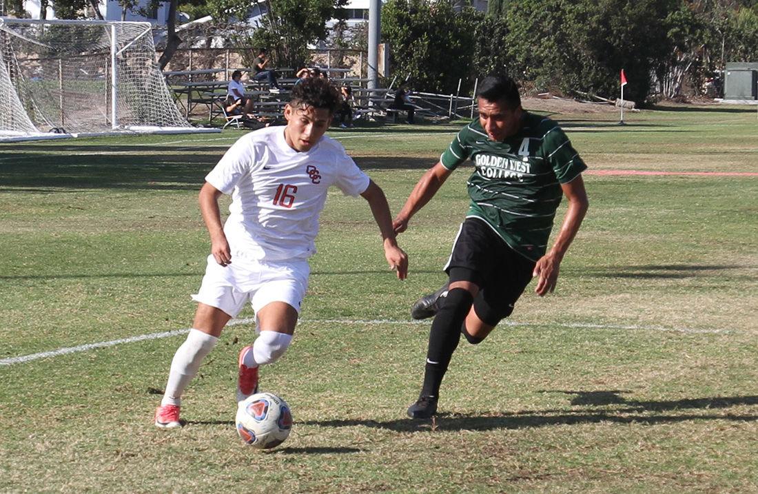 Coast soccer falls in grudge match - Photo 1