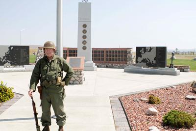 Stand in remembrance: Local man spends military holidays at