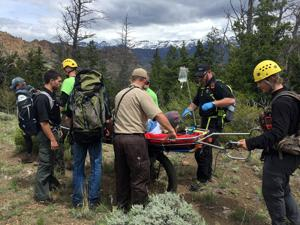 Search and Rescue members evacuate woman from North Fork