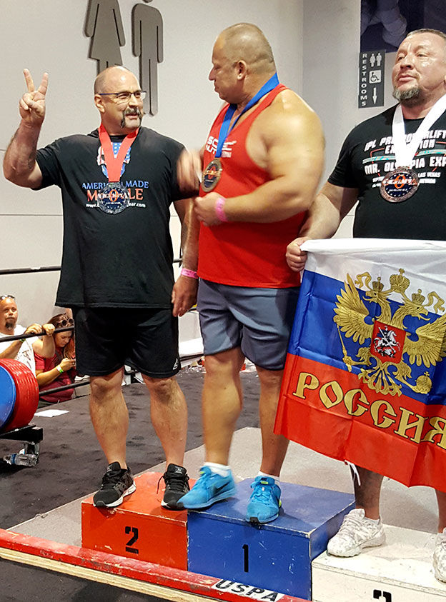 Cody man breaks record in international lifting competition