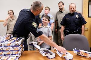 Thanking through donuts: Florida boy shows appreciation for Cody officers