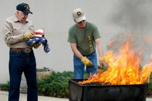 VFW members dispose of American flags at ceremony