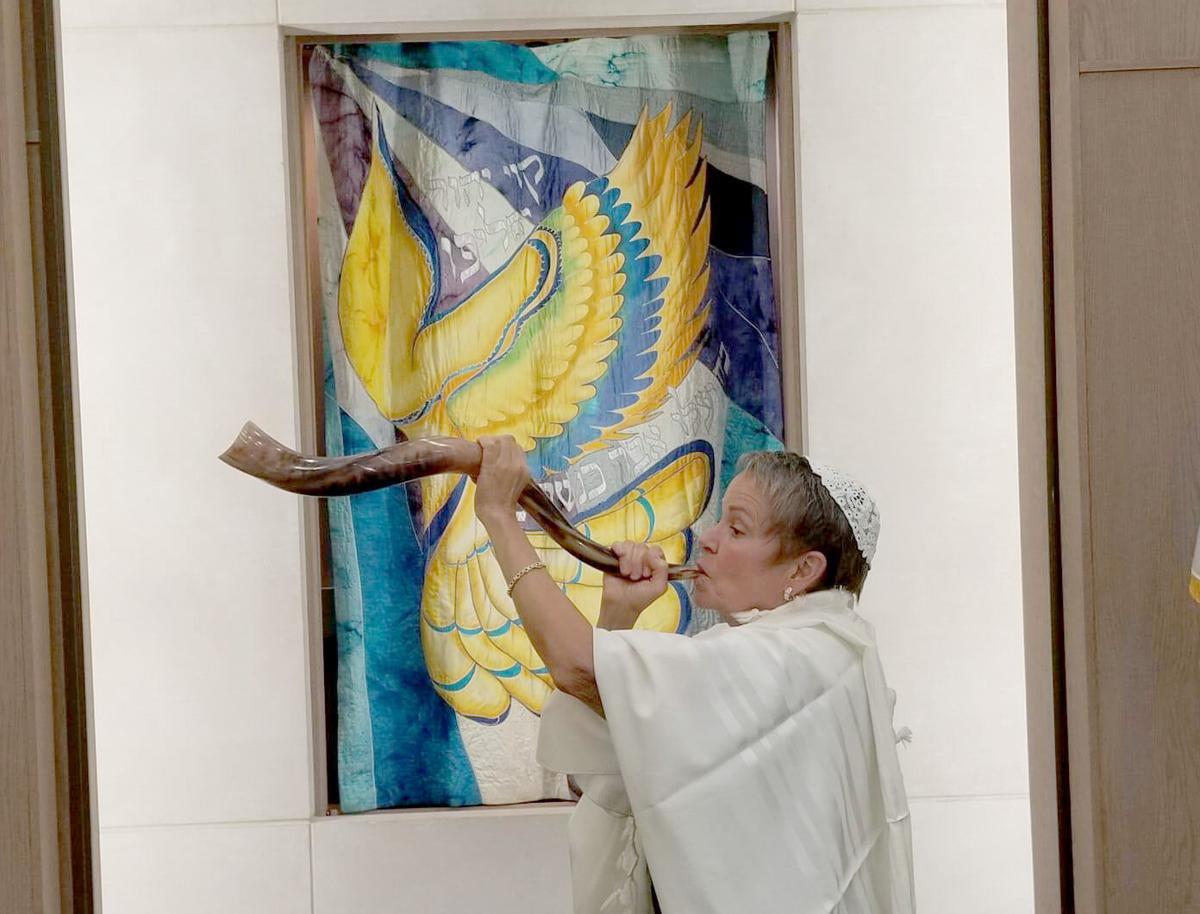 Cindy Leland blows the shofar.jpg