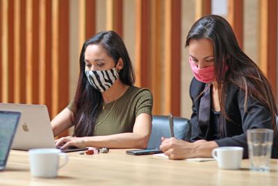stock women wearing masks
