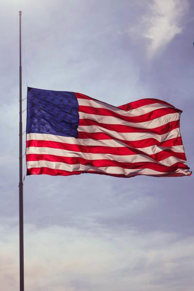 stock American flag half staff