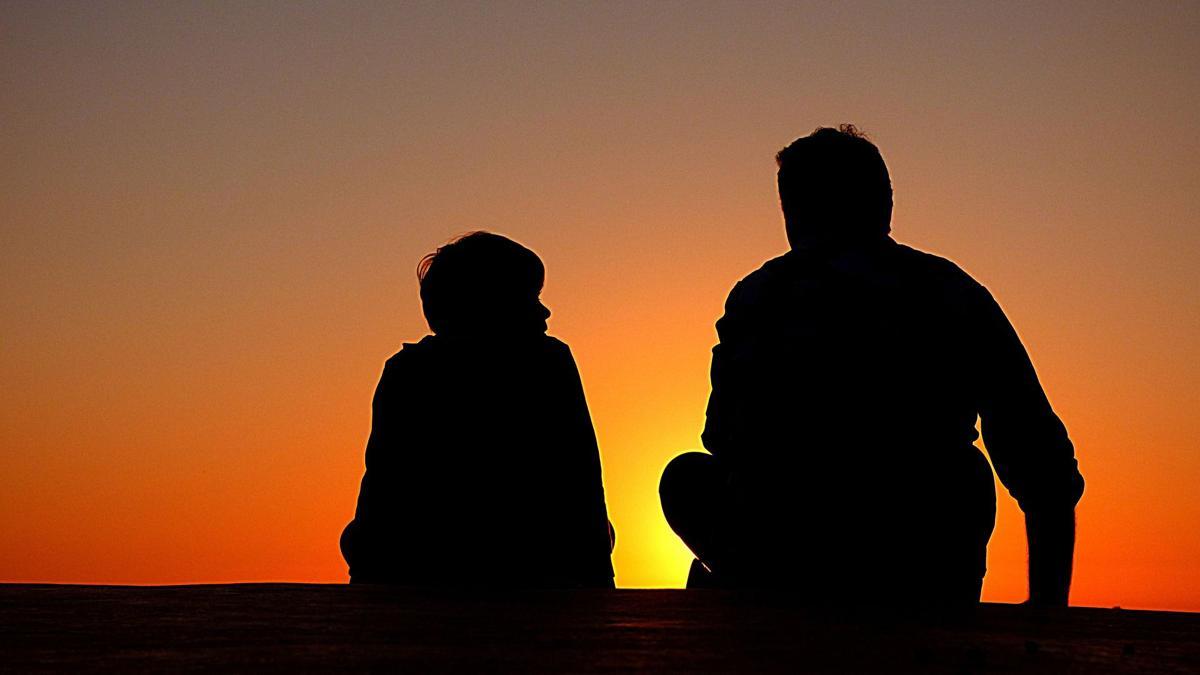 stock family silhouette sunset