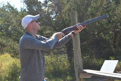 Luke Luetchens takes aim at $-H Charity Shoot