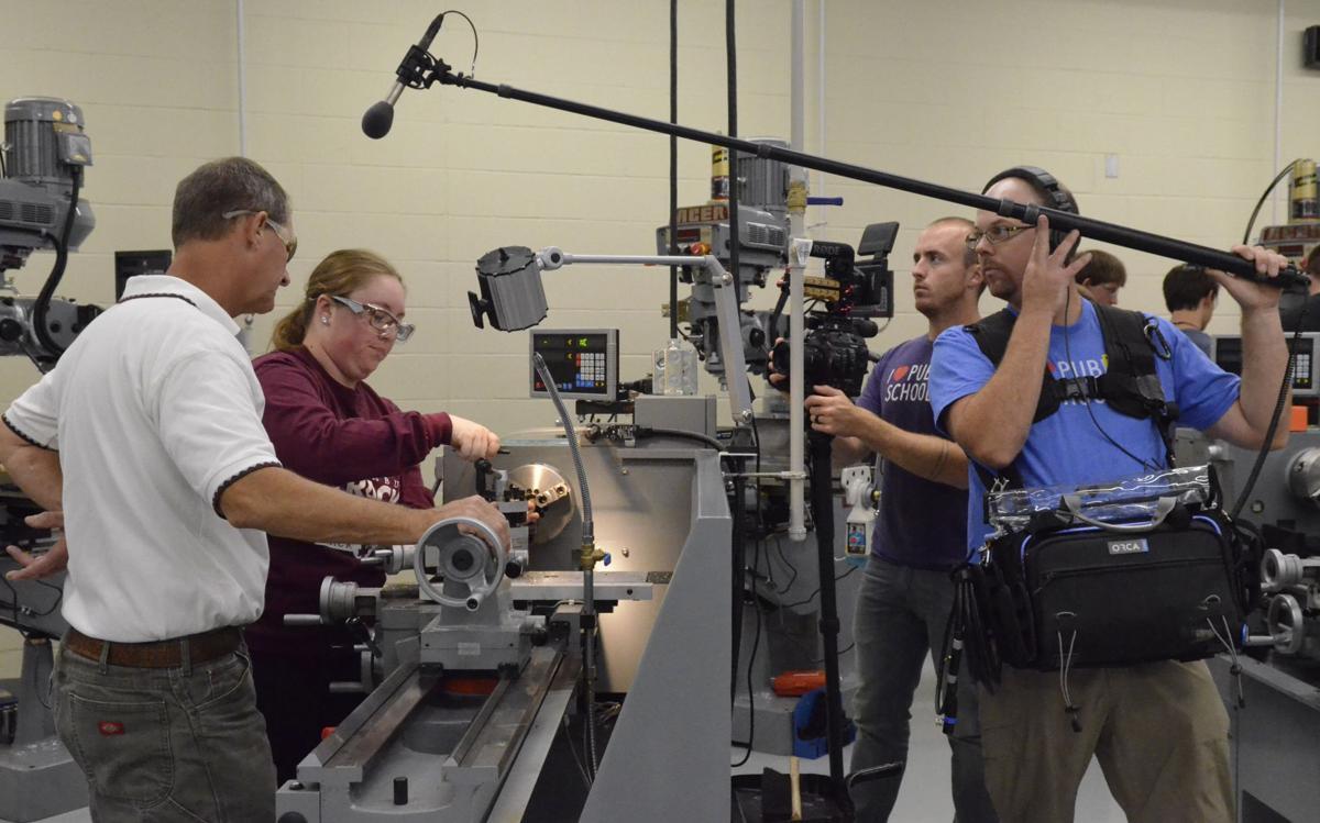 Columbus High School teacher Tracy Dodson, left, and senior Sarah  Kwapnioski are filmed Wednesday in the school's STEM Academy for a short  documentary ...