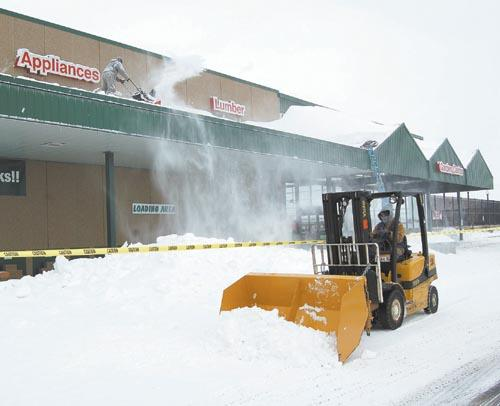 Drifts reach nearly 10 feet on Menard's awning | Local