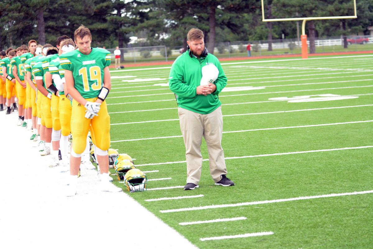Grant Shanle and head coach Tyler Linder bow their heads
