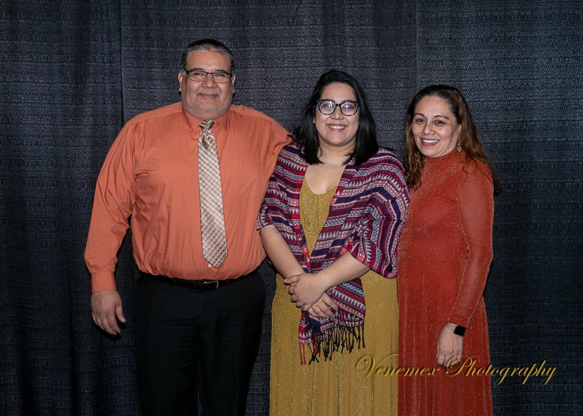 Perez with her parents