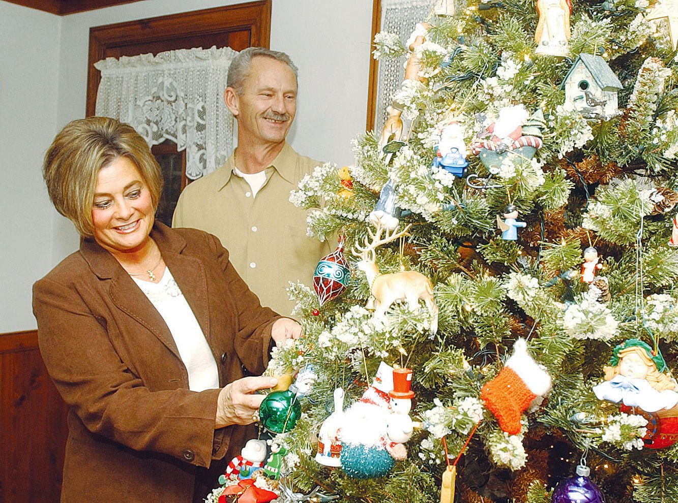 Janice And Rocky Young Of Bismarck Put The Finishing Touches On One Of The  Many Christmas Trees In Their Home. Their Home Will Be Part Of The Holiday  Tour ...